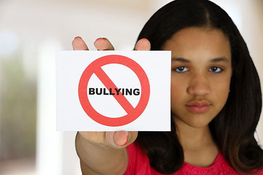 Young Girl Holding Up Anti Bullying Sign